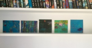 5 small works on a shelf