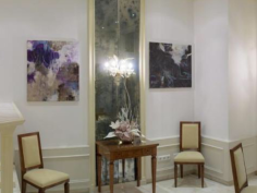 Another corner - old mirror accompanied by two paintings